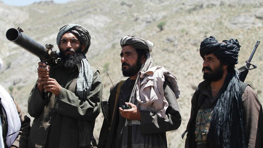 In this picture take on Friday, May 27, 2016, members of a breakaway faction of the Taliban fighters guard during a patrol in Shindand district of Herat province, Afghanistan. Afghanistan's government has offered the new Taliban leader a choice: make peace or face the same fate as his predecessor, who was killed last week in a U.S. drone strike. (AP Photos/Allauddin Khan)