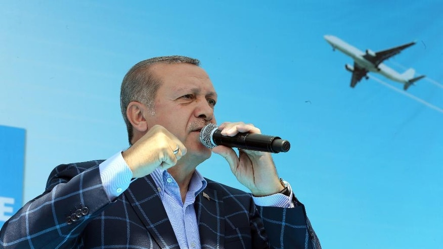 Turkey's President Recep Tayyip Erdogan addresses a rally in the mainly Kurdish city of Diyarbakir, Turkey, Saturday, May 28, 2016.  Erdogan pressed ahead with his criticism of the United States over the U.S. troops' wearing the patches of Syrian Kurdish forces, despite U.S. assurances. (Basin Bulbul, Presidential Press Service/Pool via AP)