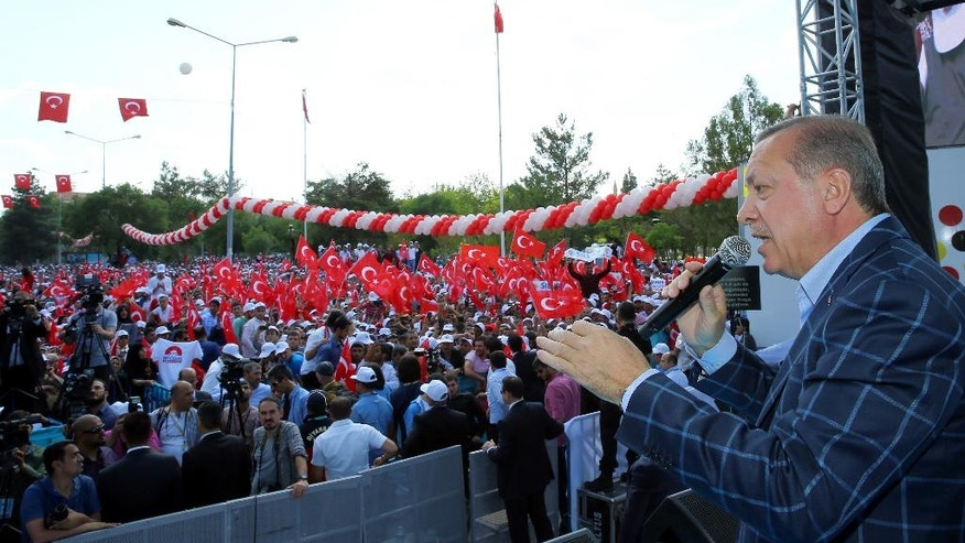 Turkey's President Recep Tayyip Erdogan addresses a rally in the mainly Kurdish city of Diyarbakir, Turkey, Saturday, May 28, 2016.  Erdogan pressed ahead with his criticism of the United States over the U.S. troops' wearing the patches of Syrian Kurdish forces, despite U.S. assurances.  (Kayhan Ozer, Presidential Press Service/Pool via AP)
