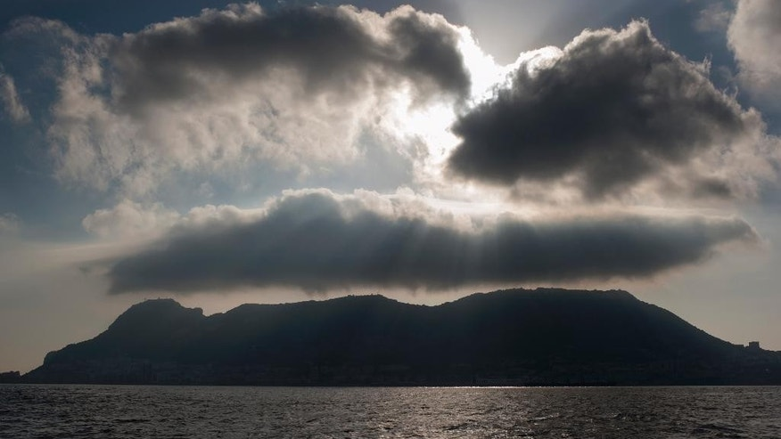 FILE - In this file photo dated Aug. 19, 2013, the rock of Gibraltar, the tiny territory on the southern tip of the Iberian peninsula, as seen from La Linea de la Concepcion, Spain.  Fabian Picardo, the chief minister of the tiny British territory, said Sunday May 29, 2016, that Gibraltar could find its access to the single European market blocked by a hostile Spanish government if the United Kingdom votes to leave the European Union in their upcoming referendum next month.  (AP Photo/Laura Leon, FILE)