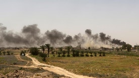 Smoke rises from Islamic State group positions at the front line during fight against Islamic State outside Fallujah, Iraq, Saturday, May 28, 2016. Days into an Iraqi military operation to push Islamic State fighters out of Fallujah, residents still inside the city are preparing for a long battle, with some saying they fear being trapped between two forces they don't fully trust. (AP Photo/Khalid Mohammed)