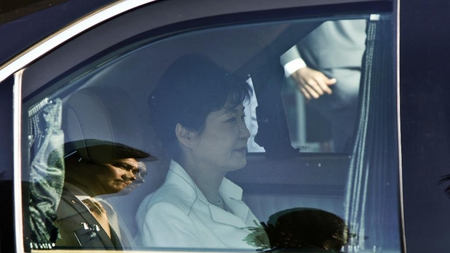South Korea's president Park Geun-hye is driven away in a car after arriving at the airport in Entebbe, Uganda, Saturday, May 28, 2016.  South Korea's president has arrived in Uganda for a two-day state visit during which she is expected to discuss business and trade opportunities, the first such visit by a South Korean president since the two countries established diplomatic ties in 1963. (AP Photo/Stephen Wandera)