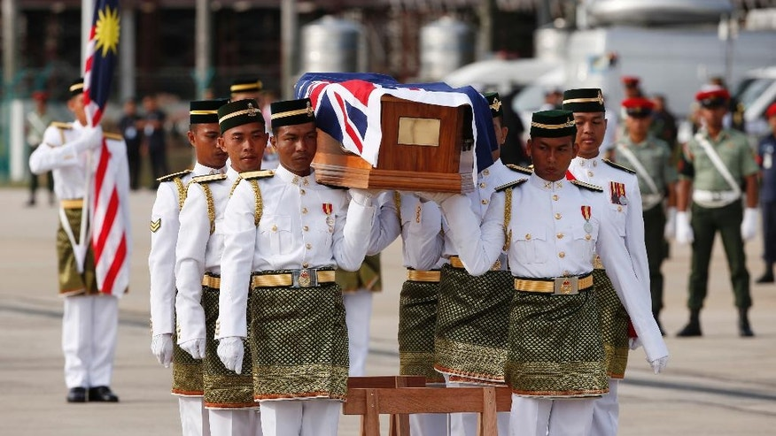 Australian military personnel carry a coffin during a repatriation ceremony for Australian soldiers at Subang military air base in Kuala Lumpur, Malaysia, Tuesday, May 31, 2016. The Australian soldiers, many who were casualties during the Vietnam War, were buried in Malaysia along with some dependents.  (AP Photo/Vincent Thian)