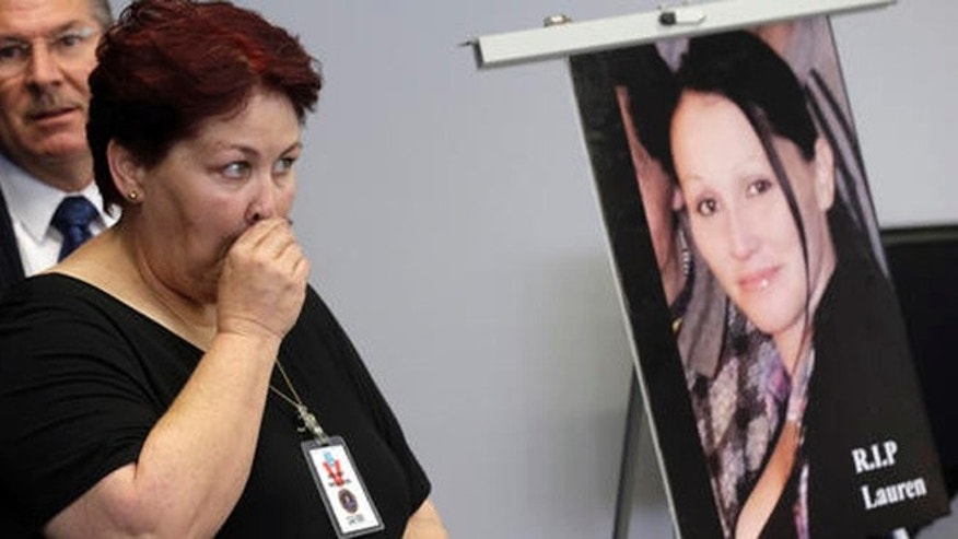 Jerilyn Olguin, mother of murder victim Lauren Elaine Olguin, seen in the photo, appears at a FBI news conference announcing additions to its 10 Most Wanted list, in Los Angeles Thursday, May 19, 2016. Fugitive Philip Patrick Policarpio is suspected in the shooting death of his pregnant girlfriend, Lauren Olguin, on April 12, 2016 in Los Angeles, has been added to the FBI's 10 Most Wanted list.(AP Photo/Nick Ut)