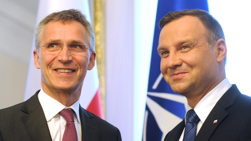 NATO Secretary General Jens Stoltenberg, left, and Polish President Andrzej Duda pose for a photo prior to a press conference in Warsaw, Poland, Monday, May 30, 2016. Stoltenberg came to Poland for a two-day visit ahead of the NATO summit in Warsaw in July. (AP Photo/Alik Keplicz)