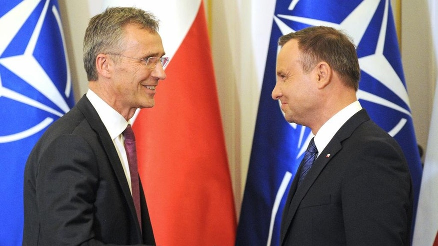 NATO Secretary General, Jens Stoltenberg, left, and Polish President, Andrzej Dud,a shake hands after a press conference in Warsaw, Poland, Monday, May 30, 2016. Stoltenberg came to Poland for a two-day visit, ahead of the NATO summit in Warsaw in July. (AP Photo/Alik Keplicz)