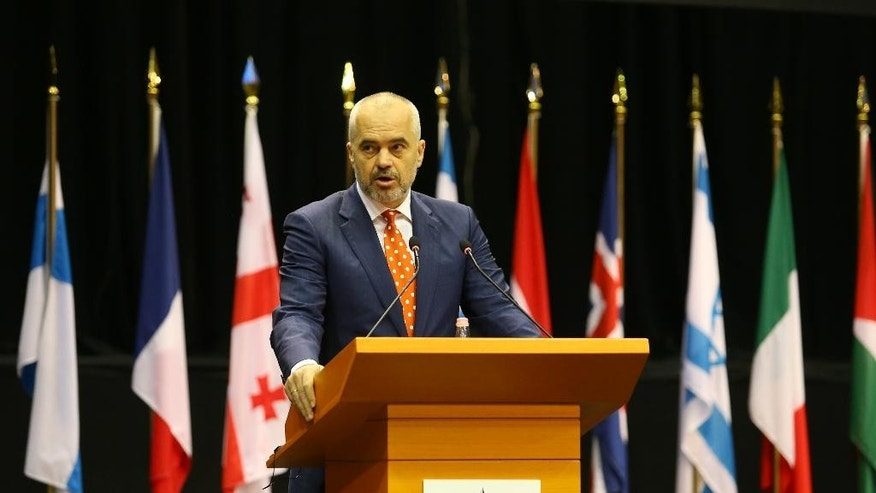Albanian Prime Minister Edi Rama at the NATO Parliamentary Assembly Spring session urging alliance members include the Western Balkans, especially Kosovo in its ranks to increase the regional and global security, in Tirana, Monday, May 30, 2016. Some 250 parliamentarians from 28 NATO-member countries and partners have gathered in a three-day session in the Albanian capital, Tirana under tight security measures.(AP Photo/Hektor Pustina)