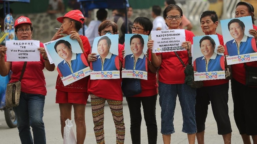 "Supporters of vice presidential candidate Sen. Ferdinand ""Bongbong"" Marcos Jr. hold slogans and pictures during a protest outside the Philippine senate in suburban Pasay, south of Manila, Philippines Monday, May 30, 2016. Marcos, the son of a dictator ousted in a 1986 ""people power"" revolt sparked by widespread human rights abuses and corruption, has raised doubts on the election results of the vice presidential race. (AP Photo/Aaron Favila)"