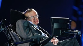 """FILE - In this file photo dated Wednesday Aug. 29, 2012, British physicist, Professor Stephen Hawking speaks during the Opening Ceremony for the 2012 Paralympics in London, Wednesday Aug. 29, 2012. Hawking was interviewed on British TV Monday May 30, 2016, saying UK should stay inside the European Union because of its support for research, and he cannot fathom the popularity of presumptive candidate for U.S. president Donald Trump, saying he """"seems to appeal to the lowest common denominator.""""  (AP Photo/Matt Dunham, FILE)"""