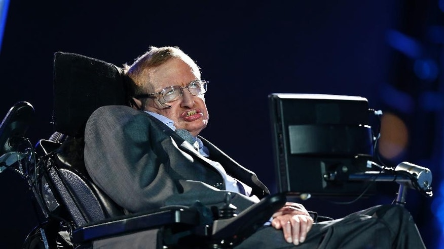 "FILE - In this file photo dated Wednesday Aug. 29, 2012, British physicist, Professor Stephen Hawking speaks during the Opening Ceremony for the 2012 Paralympics in London, Wednesday Aug. 29, 2012. Hawking was interviewed on British TV Monday May 30, 2016, saying UK should stay inside the European Union because of its support for research, and he cannot fathom the popularity of presumptive candidate for U.S. president Donald Trump, saying he ""seems to appeal to the lowest common denominator.""  (AP Photo/Matt Dunham, FILE)"