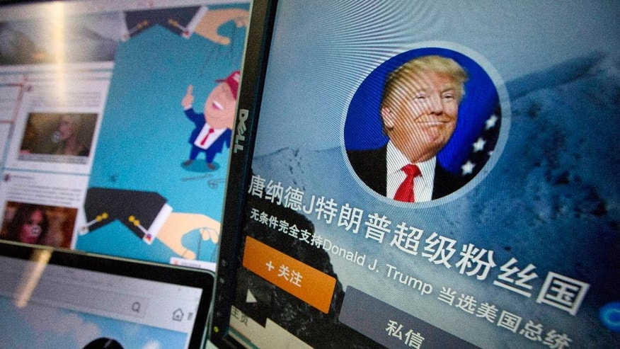 "In this May 18, 2016 photo, Chinese fan websites for Donald Trump are displayed on a computer with the words ""Donald J. Trump super fan nation, Full and unconditional support for Donald J. Trump to be elected U.S. president"" in Beijing, China. China features prominently in the rhetoric of presumed Republican presidential candidate Donald Trump, who accuses the country of stealing American jobs and cheating at global trade. In China itself, though, he's only now emerging as a public figure, despite a notoriety elsewhere for his voluble utterances, high-profile businesses and reality TV show. (AP Photo/Ng Han Guan)"