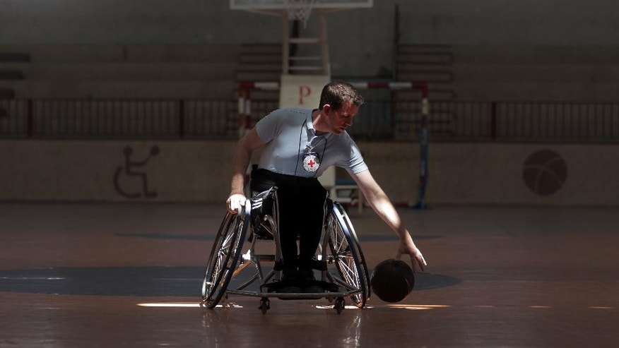 "In this Saturday, May 28, 2016 photo, U.S. coach, Jess Markt. trains the first female wheelchair basketball team in the Khan Younis refugee camp, southern Gaza Strip. ""I think for Gaza this is a very unique thing,"" said Markt. ""I think there are not so many opportunities for women to play sports here, and particularly for disabled women."" (AP Photo/Khalil Hamra)"