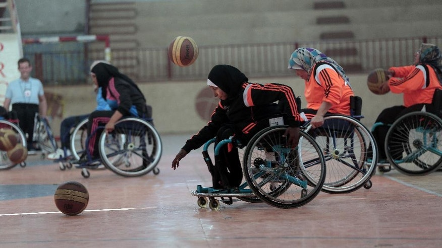 "In this Saturday, May 28, 2016 photo, disabled Palestinian women take part in a basketball training session held by top U.S. coach Jess Markt., in the Khan Younis refugee camp, southern Gaza Strip. A top U.S. coach is in the Gaza Strip to help set up the territory's first female wheelchair basketball team. ""I think for Gaza this is a very unique thing,"" said Markt. ""I think there are not so many opportunities for women to play sports here, and particularly for disabled women."" (AP Photo/Khalil Hamra)"