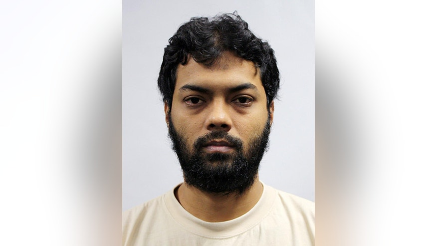This undated photo released by the Ministry of Home Affairs shows Rahman Mizanur, one of four Bangladeshi men convicted in a Singapore Court on Tuesday, May 31, 2016, in Singapore.  Mizanur and the three other men held on suspicion of planning attacks linked to the Islamic State group in their own country were convicted of financing terrorism by a court in Singapore on Tuesday.  (AP Photo/Ministry of Home Affairs)