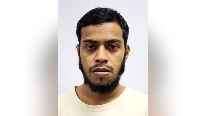 This undated photo released by the Ministry Of Home Affairs shows Miah Rubel, one of four Bangladeshi men convicted in a Singapore Court on Tuesday, May 31, 2016, in Singapore. Rubel and the three other men held on suspicion of planning attacks linked to the Islamic State group in their own country were convicted of financing terrorism by a court in Singapore on Tuesday. (AP Photo/Ministry of Home Affairs)