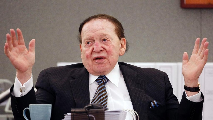 "FILE - In this May 5, 2015, file photo, Las Vegas Sands Corp. Chairman and CEO Sheldon Adelson testifies in court in Las Vegas. Billionaire Adelson's casino company is settling a long-running lawsuit with the former head of its Chinese arm. Sands China said Wednesday, June 1, 2016, that both sides ""reached a comprehensive and confidential settlement"" with Steven Jacobs, the company's former CEO. Jacobs' wrongful termination case against Adelson and Sands China's parent, Las Vegas Sands Corp., had threatened to air boardroom decisions about how the company developed its lucrative interests in the Chinese gambling enclave of Macau. (AP Photo/John Locher, File)"