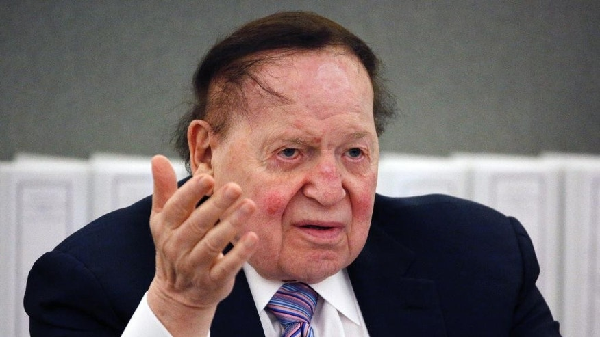 "FILE - In this May 4, 2015, file photo, Las Vegas Sands Corp. Chairman and CEO Sheldon Adelson speaks in Las Vegas. Billionaire Adelson's casino company is settling a long-running lawsuit with the former head of its Chinese arm. Sands China said Wednesday, June 1, 2016, that both sides ""reached a comprehensive and confidential settlement"" with Steven Jacobs, the company's former CEO. Jacobs' wrongful termination case against Adelson and Sands China's parent, Las Vegas Sands Corp., had threatened to air boardroom decisions about how the company developed its lucrative interests in the Chinese gambling enclave of Macau. (AP Photo/John Locher, File)"