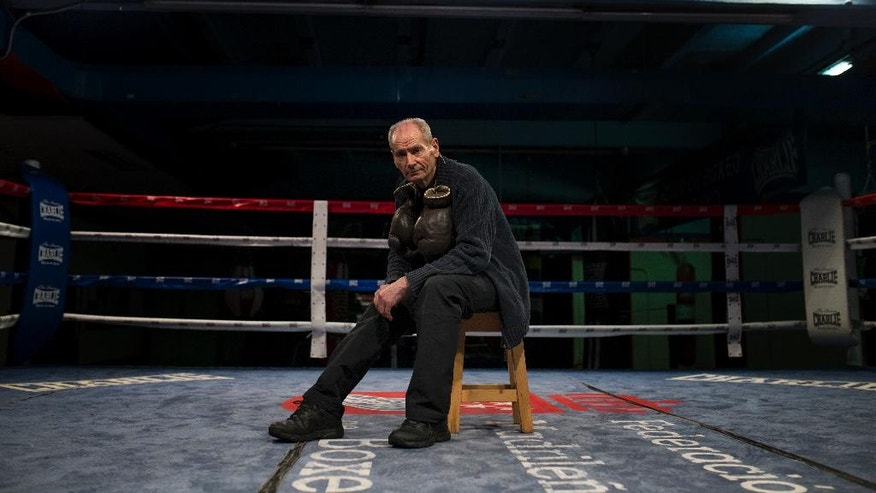 In this Thursday, May 19, 2016 photo, boxing coach Manolo del Rio poses for a photograph inside the ring at El Rayo boxing gym in Madrid, Spain. At 84, Manolo del Rio is something of a legend in Spanish boxing circles, having spent more than 65 years training some of the country's best fighters and pledging to keep on going until he drops. (AP Photo/Francisco Seco)