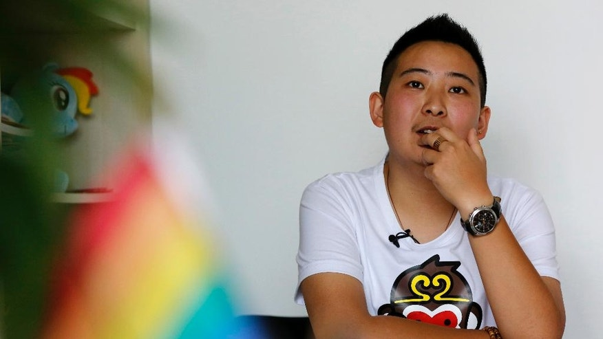 "In this May 18, 2016, photo, a transgender equal rights supporter who goes by the name of ""Mr. C"", pauses during an interview in Beijing. The 28-year-old transgender man, who keeps his real name secret to protect his parents' privacy, has become the public face of the fight for job equality in China, where sexual and gender minorities are only beginning to emerge from virtual invisibility. (AP Photo/Andy Wong)"