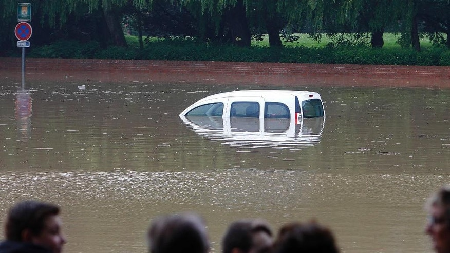 A car is half-submerged on a flooded road caused by heavy rain in Bruay La Buissieres, northern France, Tuesday, May 31, 2016. Rescue workers have evacuated homes or ordered people to higher floors in the Pas-de-Calais region in the north as rivers rose more than a meter (3 feet, 4 inches) in some spots, according to the local administration. (AP Photo/Michel Spingler)