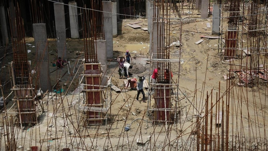 Laborers work at a construction site in the Noida suburb of New Delhi, India, Tuesday, May 31, 2016. The UN's mid-2016 report on the World Economic Situation and Prospects released earlier this month expects India to grow by 7.3 per cent this year and 7.5 per cent next year, the strongest GDP growth rate for a large economy, despite the drought affecting millions of people in various states. (AP Photo/Altaf Qadri)