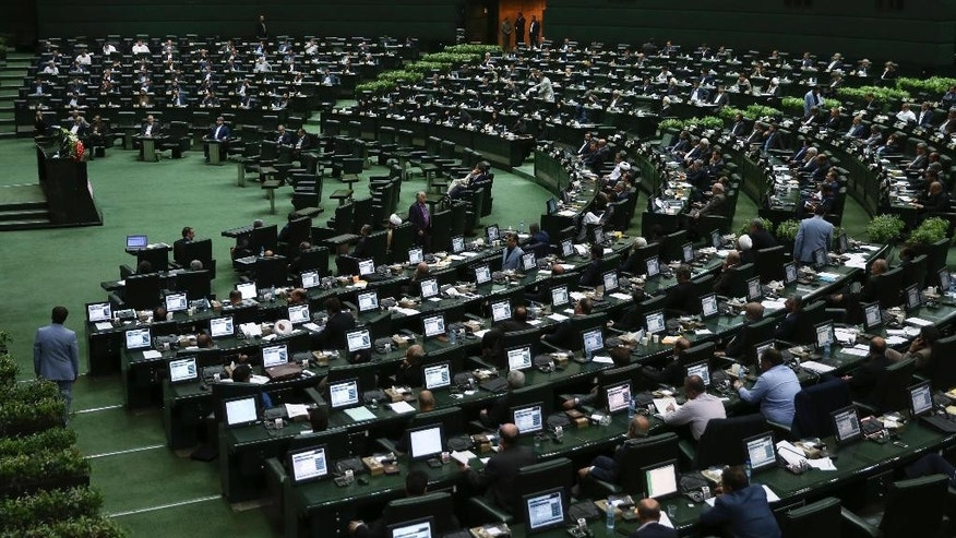 The Iranian parliament during an open session to choose interim presiding board in Tehran, Iran, Sunday, May 29, 2016. Iran's long-serving parliament speaker Ali Larijani will retain his post despite gains by reformists in elections held earlier this year, the official IRNA news agency reported Sunday. (AP Photo/Vahid Salemi)