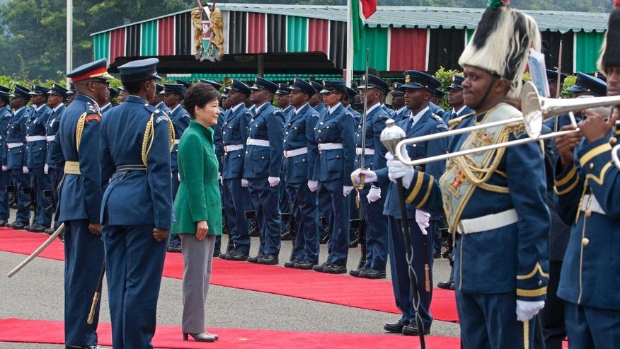 South Korea's president Park Geun-hye receives a salute from the Kenyan Air Force commander during an honor guard welcoming ceremony at the Nairobi State House in Nairobi, Kenya, Tuesday, May 31, 2016. Park arrived in Kenya for a two-day state visit during which she is expected to discuss business and trade opportunities, the first such visit by a South Korean president. (AP Photo/Sayyid Abdul Azim)