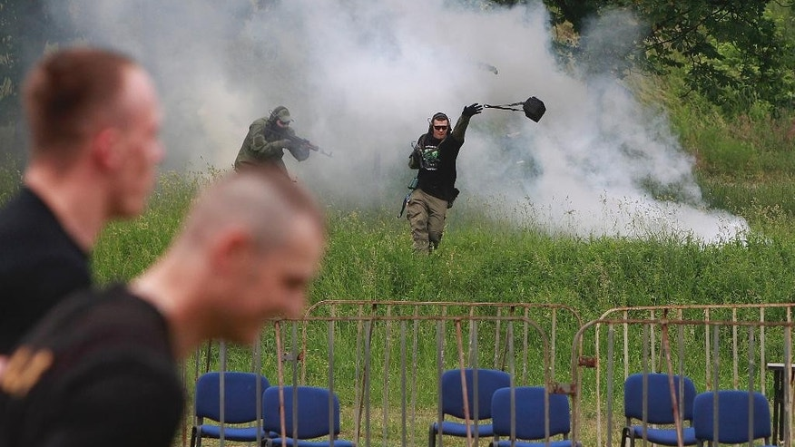 Members of the Polish Army military police anti terrorist squad  train during a  simulated attack of terrorists near the  National Stadium in Warsaw, Poland, Tuesday, May 31, 2016. The exercise was a part of preparations for the upcoming NATO summit in Warsaw in July.  (AP Photo/Czarek Sokolowski)