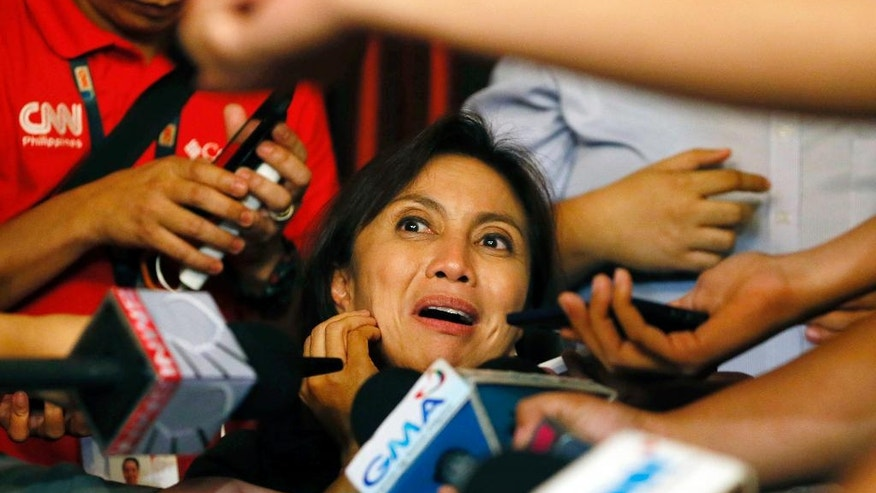 FILE - In this May 30, 2016 file photo, Philippine vice president-elect Leni Robredo answers questions from the media following her proclamation by Senate President Franklin Drilon and House Speaker Feliciano Belmonte in a joint session at the House of Representatives in suburban Quezon city, northeast of Manila, Philippines. Robredo defeated Sen. Ferdinand Marcos Jr., son and namesake of the late dictator, in a cliffhanger race for vice president in May. (AP Photo/Bullit Marquez, File)