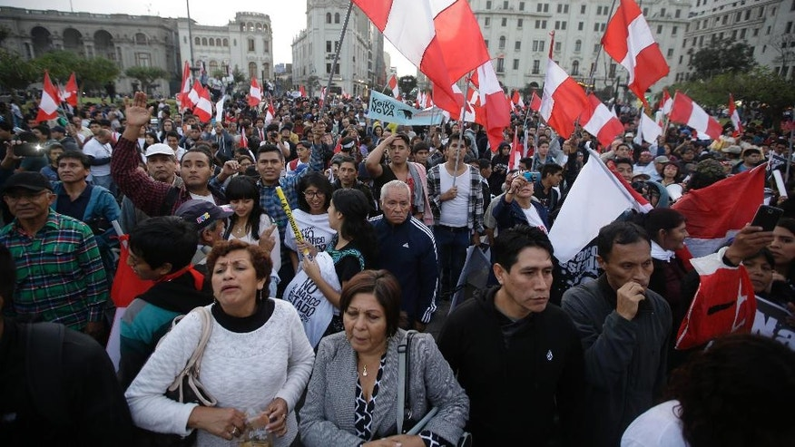 Demonstrators take part in a protest against presidential candidate Keiko Fujimori , in downtown Lima, Peru, Tuesday, May 31, 2016. The South American country is gearing up for a tight June 5th runoff between Keiko, the daughter of jailed former President Alberto Fujimori, and former World Bank economist Pedro Pablo Kuczynski. (AP Photo/Martin Mejia)