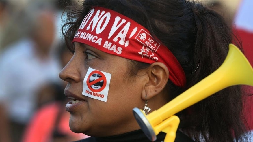 "A demonstrator wearing a headband with a message that reads in Spanish: ""Reject Keiko! Fujimori never again"" takes part in a protest against presidential candidate Keiko Fujimori, the daughter of disgraced former leader Alberto Fujimori, at Plaza San Martin in downtown Lima, Peru, Tuesday, May 31, 2016. The South American country is gearing up for a tight June 5th runoff between Keiko and former World Bank economist Pedro Pablo Kuczynski. (AP Photo/Martin Mejia)"