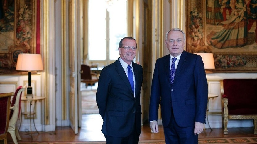 French Foreign Minister Jean Marc Ayrault, left, and U.N. envoy for Libya Martin Kobler prior to a meeting at the Quai d'Orsay, in Paris, Tuesday, May 31, 2016. Kobler is in Paris to discuss international efforts to support the new Libyan government. (AP Photo/Thibault Camus)