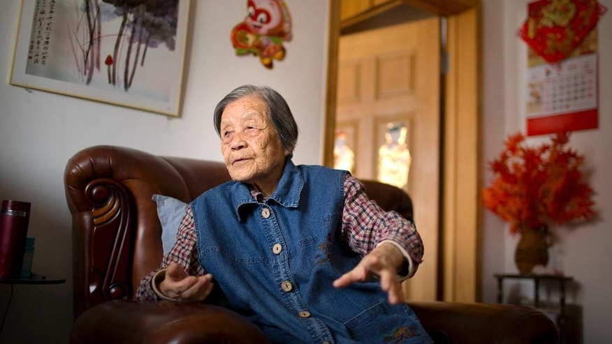 In this Tuesday, May 17, 2016 photo, Cheng Bi, a 93-year-old retired Beijing school administrator, pauses during an interview at her home in Beijing. Cheng was abused by many students but believes two students — whose names she still remembers — should have apologized for their particularly brutal acts against her during the Cultural Revolution. One is dead, and she does not expect the other to apologize. She recalled how she was forced to kneel with her arms raised while one of the students beat her wrists repeatedly. The other whipped her 45 times, turning her body purple. (AP Photo/Mark Schiefelbein)