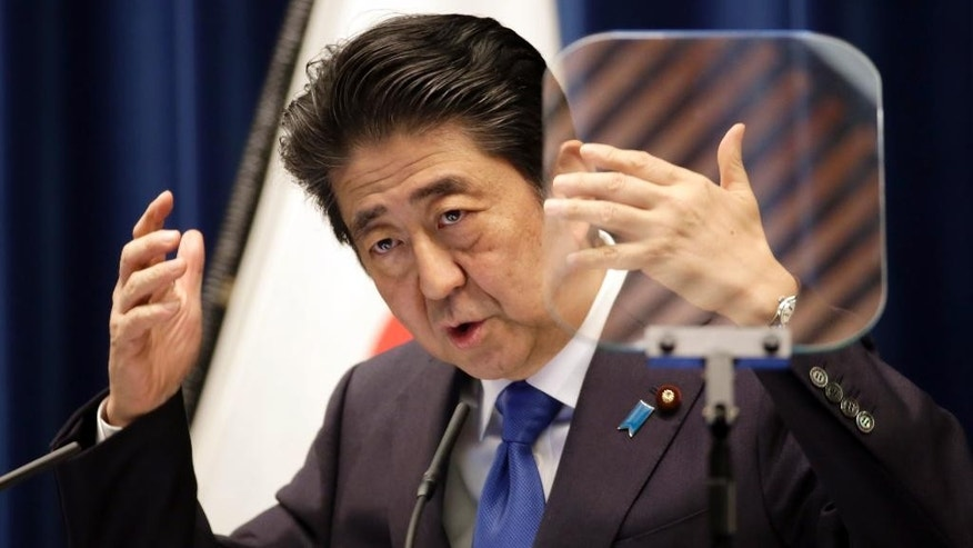 Japanese Prime Minister Shinzo Abe speaks during a press conference at the prime minister's official residence in Tokyo Wednesday, June 1, 2016. Abe said Wednesday he is postponing a sales tax hike planned for next year to help nurse along Japan's faltering economic recovery.(AP Photo/Eugene Hoshiko)