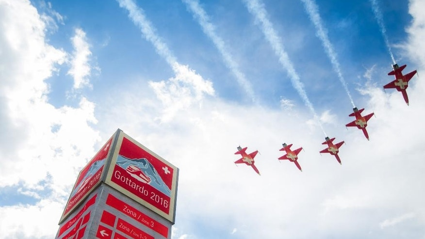 The Patrouille Suisse performs on the opening day of the Gotthard rail tunnel, at the fairground at the southern portal in Pollegio, Switzerland, Wednesday, June 1, 2016. The construction of the 57 kilometer long tunnel began in 1999, the breakthrough was in 2010. (Samuel Golay/Keystone,Ti-Press via AP)