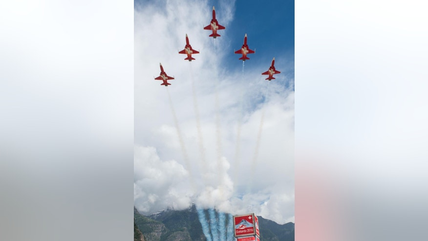 The Patrouille Suisse performs on the opening day of the Gotthard rail tunnel,  at the fairground in Pollegio, Switzerland, Wednesday, June 1, 2016. The construction of the 57 kilometer long tunnel began in 1999, the breakthrough was in 2010. ( Gabriele Putzu/Keystone,Ti-Press via AP)