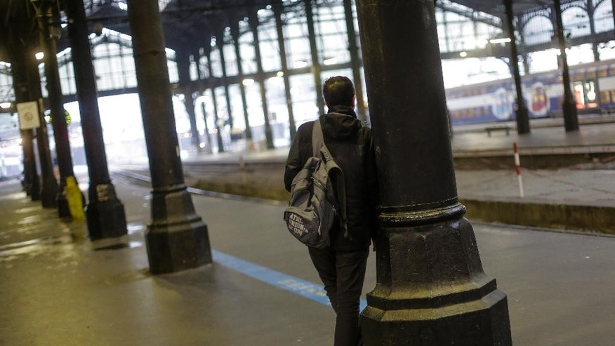 A man stands on an empty platform after a strike starts at the Gare Saint Lazare train station, in Paris, Wednesday, June 1, 2016. Workers at the SNCF national rail authority, whose train service will be crucial to the upcoming Euro 2016 football championship spectators, are on an open-ended strike to protest their working conditions and a controversial government labor reform. (AP Photo/Markus Schreiber)