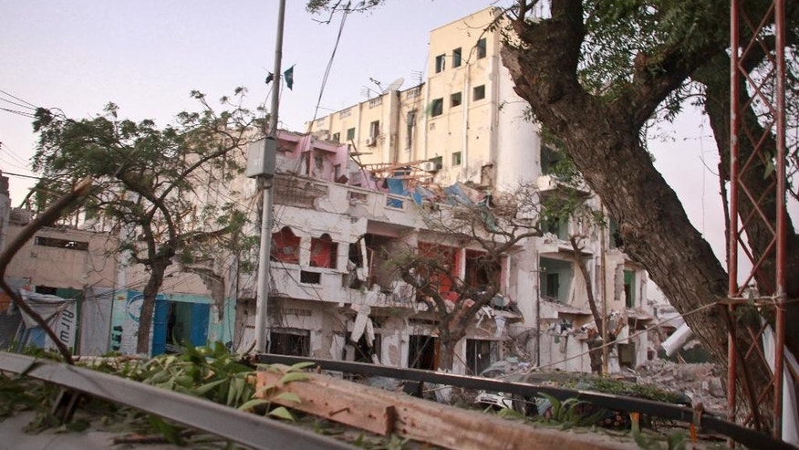 The scene of a bomb attack on an hotel in Mogadishu, Somalia Wednesday, June 1, 2016. The attack took place on the Ambassador hotel, which is often frequented by government officials and business executives. (AP Photo/Farah Abdi Warsameh)