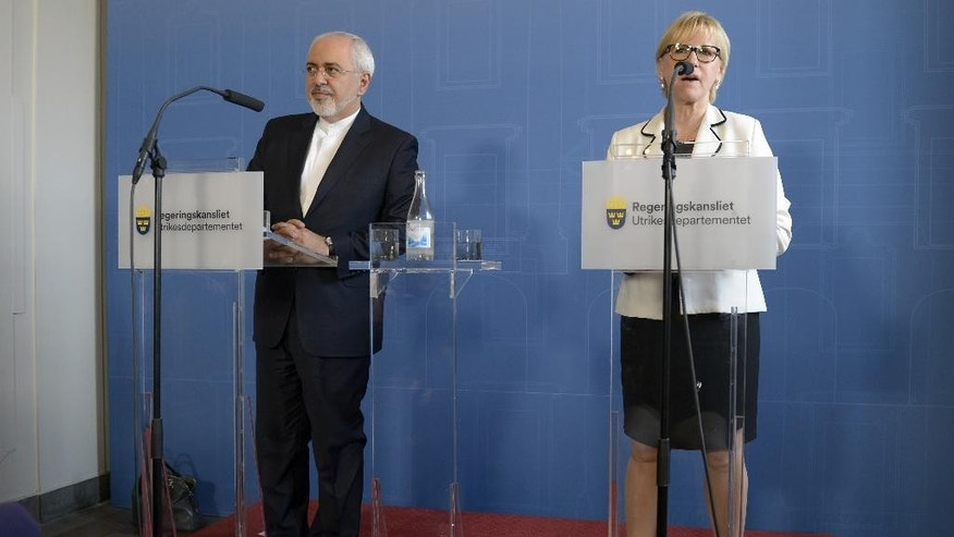 Iran's Foreign Minister Mohammad Javad Zarif, left, looks on during a joint press conference with his Swedish counterpart Margot Wallstrom, at the Ministry for Foreign Affairs in Stockholm, on Wednesday, June 1, 2016. Zarif is on an official visit to Sweden. (Maja Suslin/TT News Agency via AP)      SWEDEN OUT