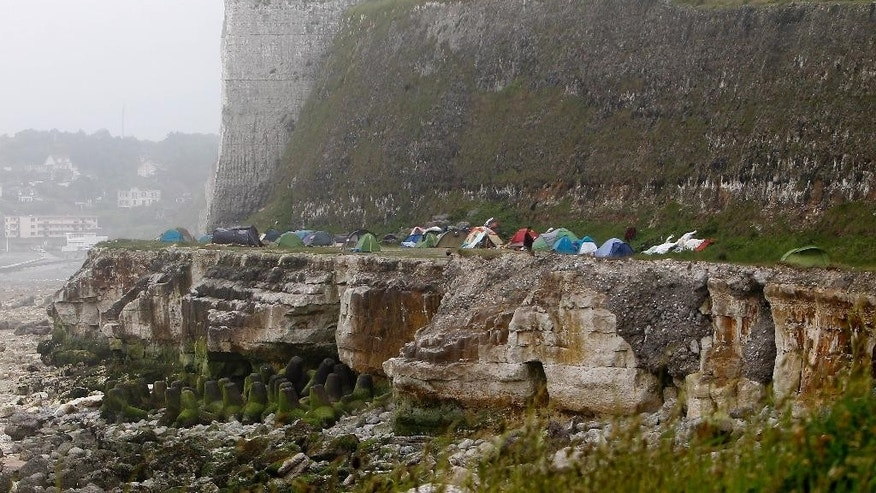 Migrants' tents are set up in a new makeshift camp along the storm-hit cliffs near the port of Dieppe, northern France, Wednesday, June 1, 2016. A group of around 150 Albanian migrants set up camp near the English channel hoping to cross to the UK. (AP Photo/Michel Spingler)