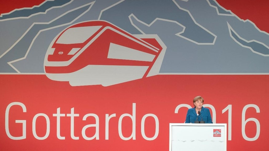 German Chancellor Angela Merkel delivers a speech on the opening day of the Gotthard rail tunnel, t  at the fairground in Pollegio, Switzerland, Wednesday, June 1, 2016. The construction of the 57 kilometer long tunnel began in 1999, the breakthrough was in 2010. (Pablo Gianinazzi/Keystone,Ti-Press via AP)