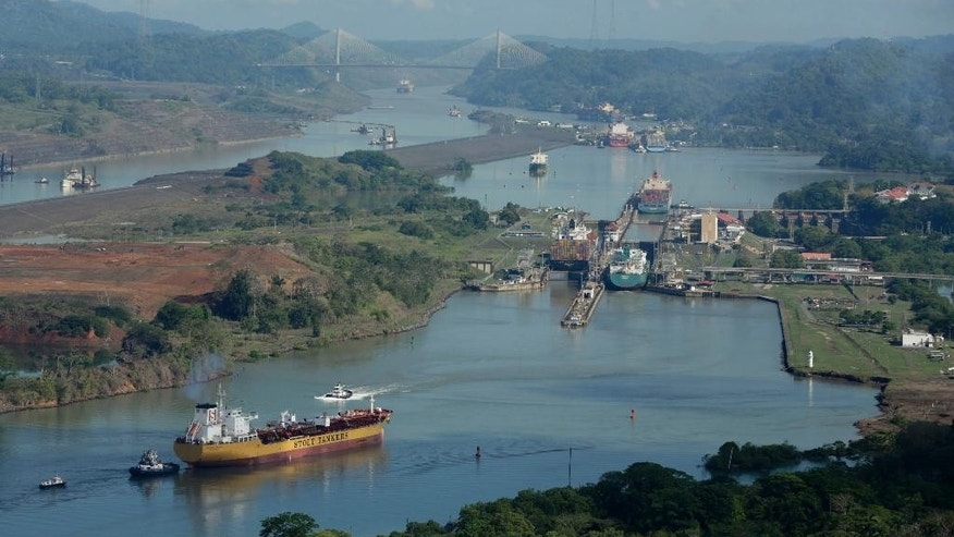 "FILE - In this May 11, 2016 file photo, ships transit through the Panama Canal near Panama City. Originally scheduled to be concluded in October 2014, the newly expanded Panama Canal will be inaugurated on June 26. The consortium designing and building the Panama Canal's new set of expanded locks, designed to accommodate massive ships known as ""New Panamax,"" said Wednesday, June 1, 2016 they are working at full capacity and ready to receive their first ships. (AP Photo/Arnulfo Franco, File)"
