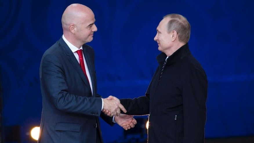 Russian President Vladimir Putin, right, and FIFA President Gianni Infantino shake hands at the opening ceremony of World Cup Volunteers Programme ahead of the 2018 football tournament in Moscow, Russia, Wednesday, June 1, 2016. Russian President Vladimir Putin and FIFA President Gianni Infantino attend launch of World Cup Volunteers Programme ahead of the 2018 football tournament. (AP Photo/Ivan Sekretarev)