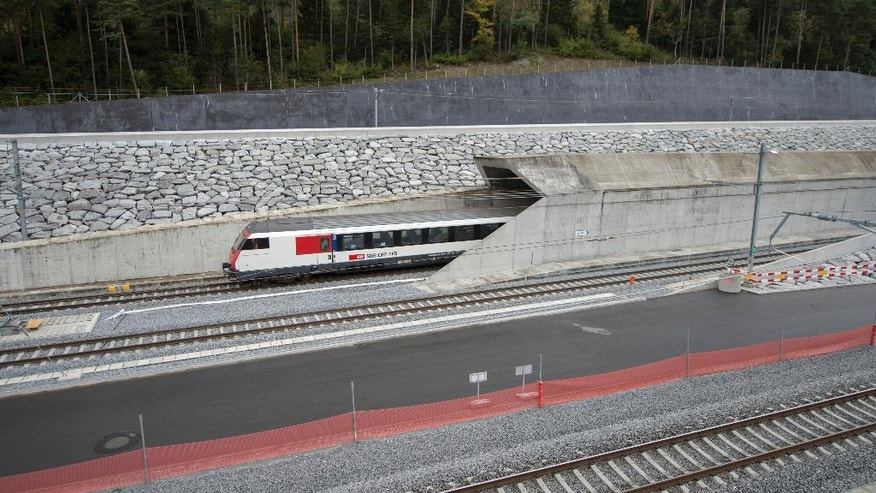 Oct. 8, 2015: A test train drives close to the northern gate near Erstfeld, Switzerland.