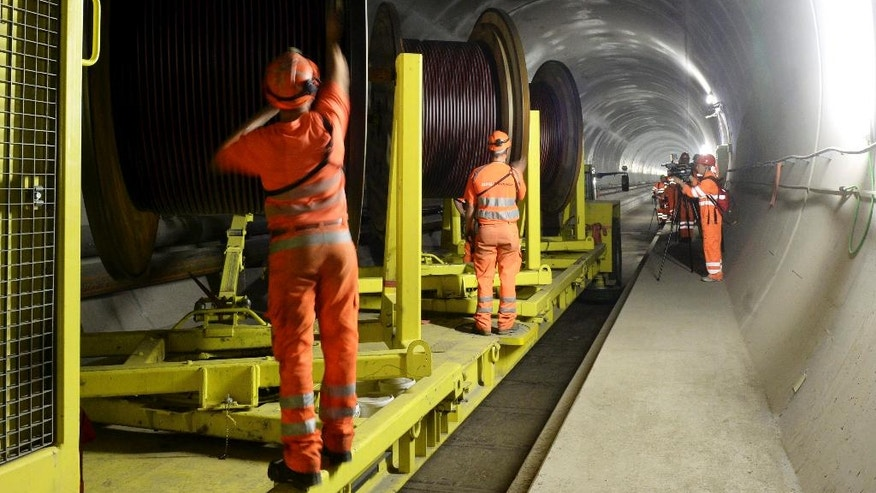 Oct. 31, 2013: Construction workers are busy in the NEAT Gotthard Base Tunnel between Biasca and Amsteg, Switzerland.