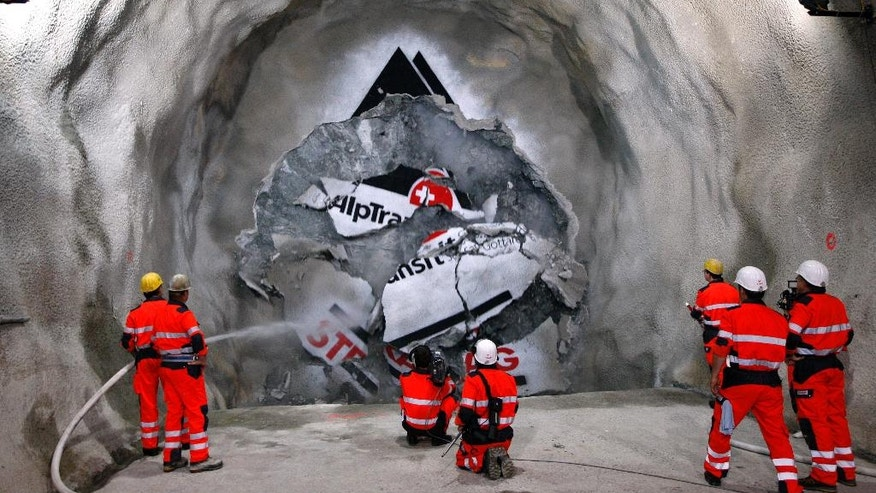 "June 16, 2009: Minors watch the tunnel drilling machine ""Gabi"" breaking through the last section of the AlpTransit ""New Railway Link through the Alps"" (NRLA) tunnel between Erstfeld and Amsteg, Switzerland."