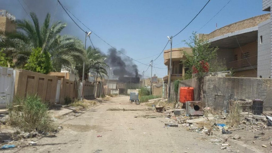 Smoke rises from a neighborhood in central Fallujah, Iraq as Iraqi counterterrorism forces battle Islamic State militants in the southern part of the city on Tuesday, May 31, 2016. The elite troops repelled a four-hour attack by the Islamic State group in the city's south a day after first moving into the southern edges of the militant-held city with the help of U.S.-led coalition airstrikes. (AP Photo)