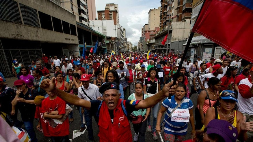 "Supporters of Venezuela's President Nicolas Maduro shout slogans during a rally to show their support in Caracas, Venezuela, Wednesday, June 1, 2016. Government supporters and state employees marched in a rally against ""foreign intervention"" in Venezuela's affairs. (AP Photo/Fernando Llano)"