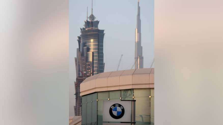 The logo of BMW car showroom is seen in Dubai, United Arab Emirates, Thursday, June 2, 2016. The BMW distributor in the capital of the United Arab Emirates has pulled a television commercial featuring the country's national anthem off the air after it sparked outrage from some citizens. (AP Photo/Kamran Jebreili)