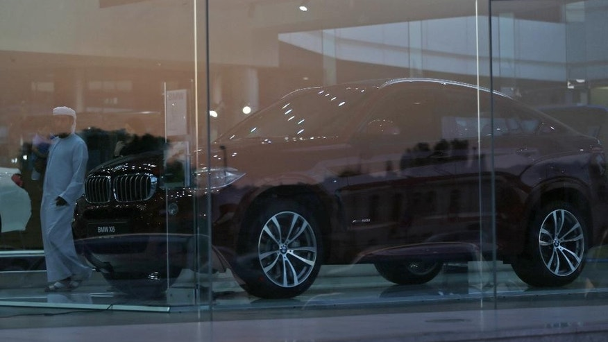 An Emirati man visits the BMW car showroom in Dubai, United Arab Emirates, Thursday, June 2, 2016. The BMW distributor in the capital of the United Arab Emirates has pulled a television commercial featuring the country's national anthem off the air after it sparked outrage from some citizens.(AP Photo/Kamran Jebreili)